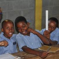 School children in Darbonne, Haiti with some stationary donated by New Zealanders