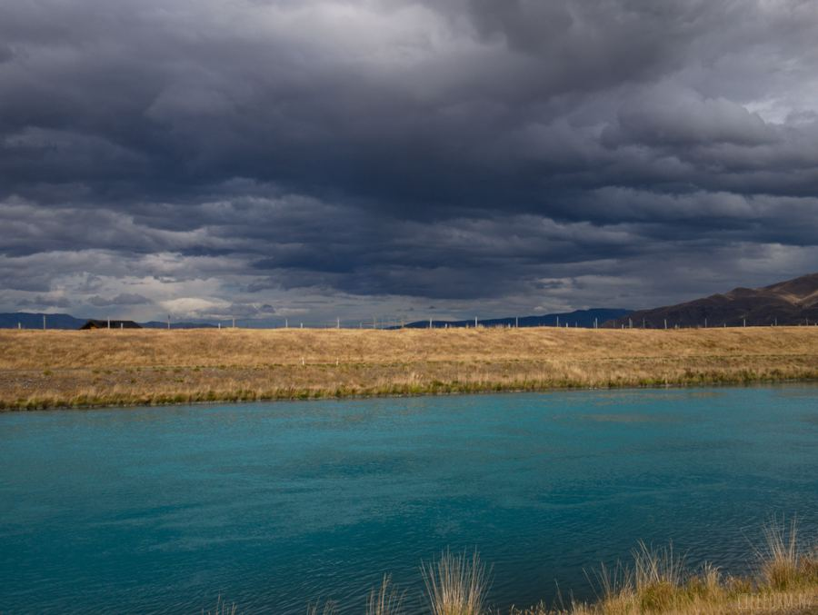 Pukaki Canal under dark clouds