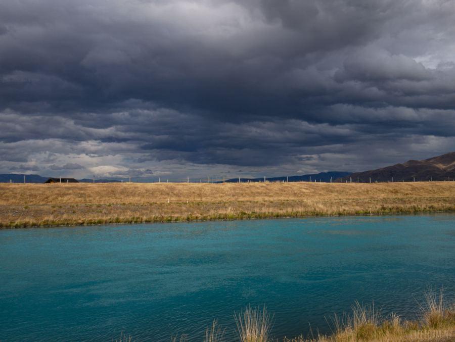 Pukaki Canal under dark clouds