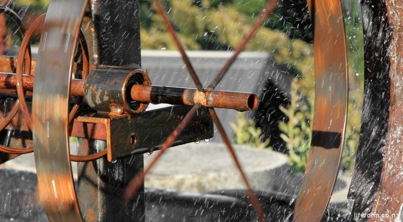 water wheel on a fountain sculpture